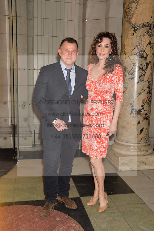 BENJAMIN AHRENS and MARIE HELVIN at a VIP preview of the V&A's new exhibition 'The Glamour of Italian Fashion' - a comprehensive look at Italian Fashion from 1945-2014 held at The Victoria & Albert Museum, London on 2nd April 2014.