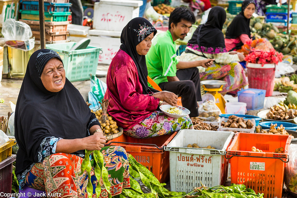 09 JULY 2013 - PATTANI, PATTANI, THAILAND: Fruit and vegetable vendors  in the market in Pattani.  Pattani, along with Narathiwat and Yala, are the only three Muslim majority provinces in Thailand.     PHOTO BY JACK KURTZ