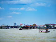 02 AUGUST 2018 - PAK KRET, NONTHABURI, THAILAND: Looking north up the Chao Phraya River from Ko Kret island. Ko Kret (also spelled Koh Kret) is a small island in the Chao Phraya River in Nonthaburi province north of Bangkok. It is about 2 km long and 1 km wide. It has seven main villages, the largest and most populous being Ban Mon. Ko Kret was created in 1722 when a canal was dug in the Chao Phraya River to bypass a bend. Most of the people on the island are ethnically Mon, from the hills of western Thailand and eastern Myanmar (Burma). The island is popular as a weekend daytrip from Bangkok. The island is famous for the Mon style pottery made on the island.      PHOTO BY JACK KURTZ