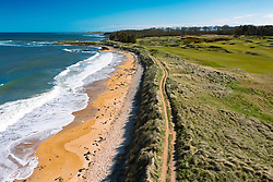 Aerial view from drone of Fife Coastal Path beside Kingsbarns Golf Links, Fife, Scotland, UK