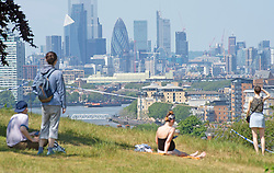 ©Licensed to London News Pictures 21/05/2020<br /> Greenwich, UK. The viewing area has been taped off due to Coronavirus grouping, this is the best view of London next to the cordon. People out and about in Greenwich park, Greenwich, London this afternoon enjoying lockdown freedom as the mini heatwave hot weather continues with temperatures set to hit 28C in parts of the UK.  Photo credit: Grant Falvey/LNP
