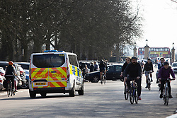 © Licensed to London News Pictures. 27/02/2021. London, UK. Police patrol a sunny Greenwich Park in South East London. The national Lockdown is expected to begin to be lifted on the 8th of March with pupils returning to schools and two members of different households allowed to meet outdoors. Photo credit: George Cracknell Wright/LNP