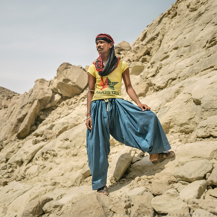 A young pilgrim takes a break from his walk. In extreme heat, pilgrims, young and old,  circumnavigate the shrine on foot, over mountain paths, stopping at springs.