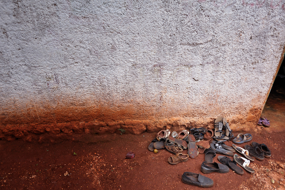 Shoes left outside the doorway to a small Pentecostal church in Mizak, a small village in the south of Haiti.