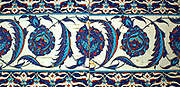 Tiles from Turkey 1550-1600 1.Pair of tiles with peonies and serrated leaves. Turkey about 1550-1560. Fritware with polychrome underglaze painting.  2. Set of four tiles with tulips, prunus sprays and serrated leaves.  Turkey 1550-1600.  Fritware, with polychrome underglaze painting.