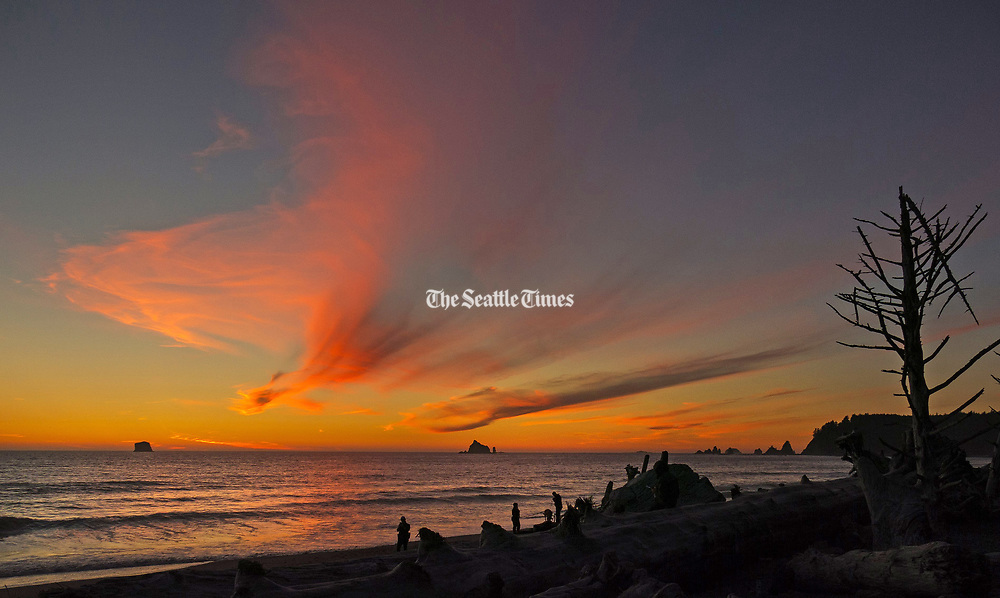Sunsets are spectacular at Rialto Beach in the Olympic National Park, about a 90-minute drive from Port Angeles. (Mike Siegel / The Seattle Times)