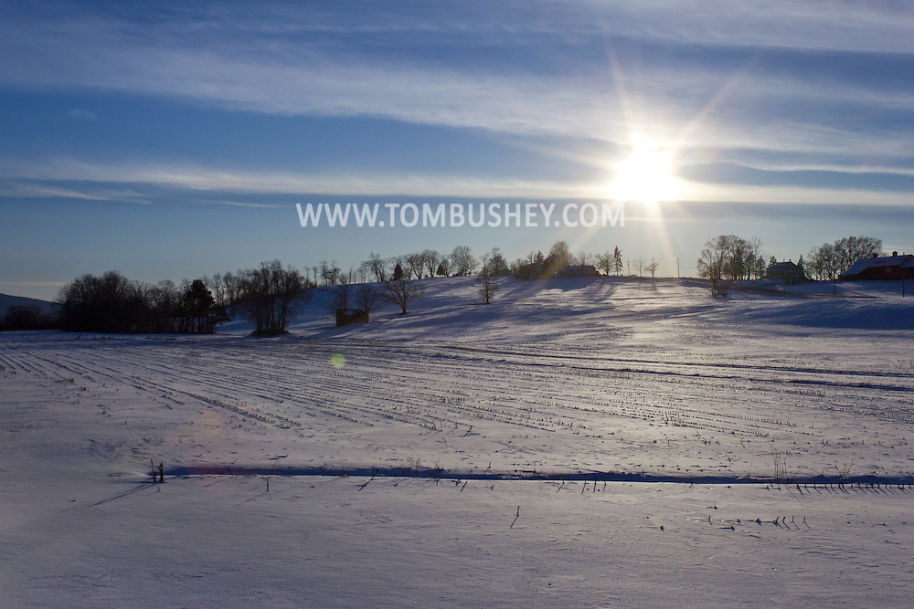 Goshen, New York - The sun shines on snow-covered fields on a farm on Feb. 10, 2013.