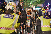 A protestor argue with police during late-night clashes with police in central London on Wednesday, June 3, 2020. (Photo/ Vudi Xhymshiti)