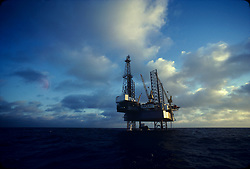 Stock photo of the view of a jack up rig from the water