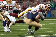 Washington Redskins linebacker Marcus Washington (53) sacks St. Louis Rams quarterback Ryan Fitzpatrick (12) in the first quarter, during the Redskins 24-9 win at the Edward Jones Dome in St. Louis, Missouri, December 4, 2005.