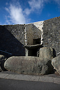 The entrance to Newgrange, showing the entrance kerbstone 1 (K1) and roofbox. On the winter solstice, the morning sun shines through the roofbox and illuminates the passage tomb inside.
