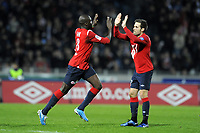 FOOTBALL - FRENCH CHAMPIONSHIP 2010/2011 - L1 - LILLE OSC v STADE BRESTOIS - 7/11/2010 - PHOTO JEAN MARIE HERVIO / DPPI - JOY MOUSSA SOW (LOSC) WITH YOHAN CABAYE AFTER HIS GOAL