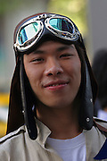 Thailand, Bangkok, young man with old style flight helmet