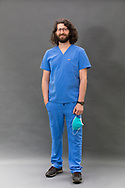 Male Nurse wearing scrubs and a face mask