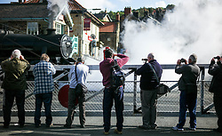 © Licensed to London News Pictures. <br /> 01/10/2016. <br /> Grosmont, UK.  <br /> <br /> Railway enthusiasts line up to photograph one of the steam locomotives during the North Yorkshire Moors Railway Autumn Steam Weekend. <br /> The hugely popular railway line runs a service between Pickering and Whitby through the picturesque North yorkshire countryside and attracts thousands of visitors each year. <br /> <br /> Photo credit: Ian Forsyth/LNP
