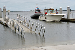 October 7, 2016 - Florida, U.S. - A boat is towed into Jensen Beach Boat Ramp Park after the passing of hurricane Matthew on October 6, 2016. (Credit Image: © Richard Graulich/The Palm Beach Post via ZUMA Wire)