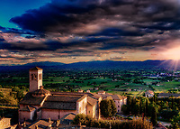 """Hotel Giotto sunset view of the Museum of San Pietro and the Crypt of San Vittorino – Assisi""...<br />