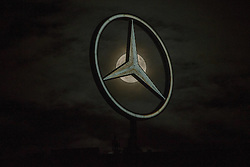 November 14, 2016 - Berlin, Germany - The Mercedes star on the top of the Europa-Center building is pictured as the so called 'super moon' raises in Berlin, Germany on November 14, 2016. The moon was in its orbit at closest point to Earth after 70 years. (Credit Image: © Emmanuele Contini/NurPhoto via ZUMA Press)