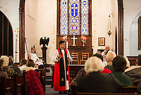 Trinity Episcopal Church in Tilton holds their final service on Sunday, February 1, 2015.  Karen Bobotas for the Laconia Daily Sun