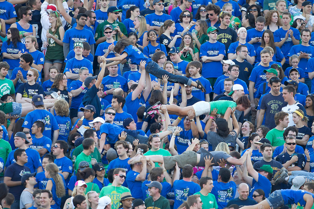 Notre Dame students celebrate touchdown while doing pushups during NCAA football game between Notre Dame and Air Force.  The Notre Dame Fighting Irish defeated the Air Force Falcons 59-33 in game at Notre Dame Stadium in South Bend, Indiana.