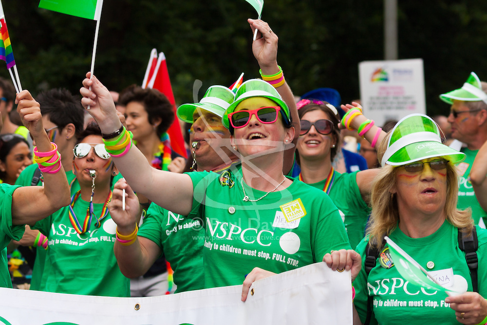 Brighton, August 2nd 2014. Campaigners for NSPCC march with the procession during Brighton Pride.