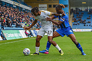 Peterborough United forward Ivan Toney (17) and Gillingham FC defender Gabriel Zakuani (6) during the EFL Sky Bet League 1 match between Gillingham and Peterborough United at the MEMS Priestfield Stadium, Gillingham, England on 22 September 2018. Picture by Martin Cole