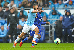 September 22, 2018 - Cardiff City, England, United Kingdom - Sergio Aguero of Manchester City and Junior Hoilett of Cardiff City battle for possession during the Premier League match between Cardiff City and Manchester City at Cardiff City Stadium,  Cardiff, England on 22 Sept 2018. (Credit Image: © Action Foto Sport/NurPhoto/ZUMA Press)