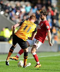 Adam Matthews of Bristol City challenges for the ball with Sam Clucas of Hull City - Mandatory by-line: Dougie Allward/JMP - 02/04/2016 - FOOTBALL - KC Stadium - Hull, England - Hull City v Bristol City - Sky Bet Championship