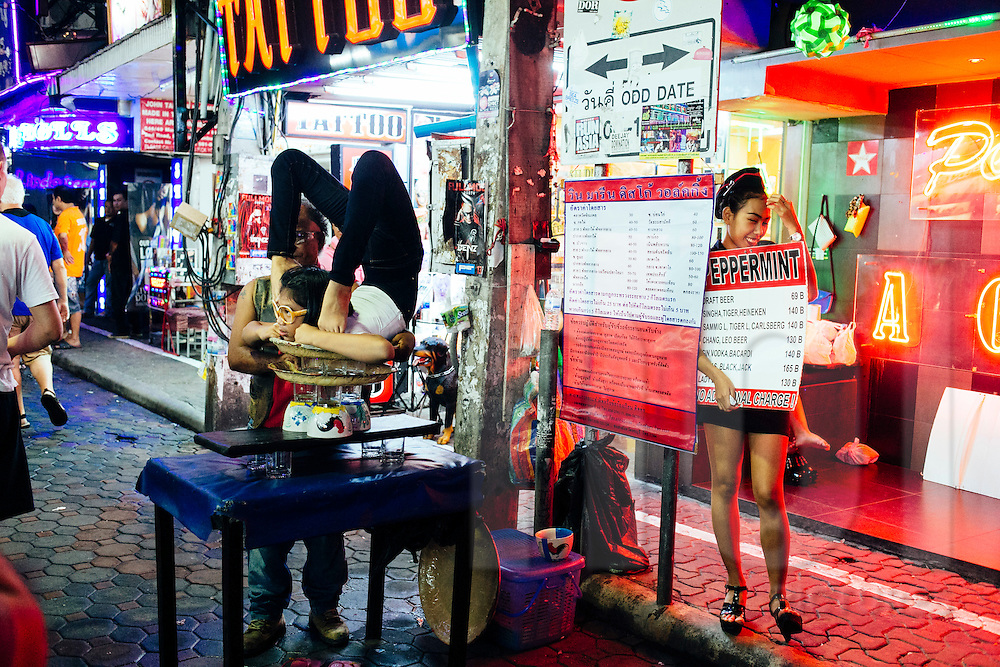Contortionist street performance in Pattaya, Thailand, Southeast Asia