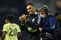 Football - 2021 / 2022 EFL Carabao Cup - Round Two - West Bromwich Albion vs Arsenal - The Hawthorns - Wednesday 25th August 2021.<br /> <br /> Arsenal's Pierre-Emerick Aubameyang salutes the fans as he carries the match ball after their 6-0 victory and his hat trick.<br /> <br /> COLORSPORT/Ashley Western