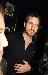 GERALD BUTLER at a party hosted by Tatler magazine to celebrate the publication of the 2004 Little Black Book held at Tramp, 38 Jermyn Street, London SW1 on 10th November 2004.<br />