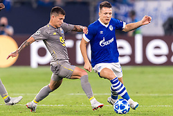 (L-R) Otávio Edmilson Da Silva Monteiro of FC Porto, Yevhen Konoplyanka of FC Schalke 04  DFL REGULATIONS PROHIBIT ANY USE OF PHOTOGRAPHS AS IMAGE SEQUENCES AND/OR QUASI-VIDEO. during the UEFA Champions League group D match between Schalke 04 and FC Porto at the Arena auf Schalke on September 18, 2018 in Gelschenkirchen, Germany