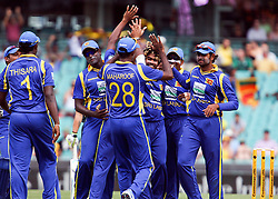 © Licensed to London News Pictures. 17/02/2012. Sydney Cricket Ground, Australia. The Sri Lankan cricket team celebrate the wicket of David Warner during the One Day International cricket match between Australia Vs Sri Lanka. Photo credit : Asanka Brendon Ratnayake/LNP