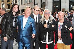 © Licensed to London News Pictures. 01/07/2013. London, UK. Rick Parfitt; Francis Rossi; Uriah Heep, Bula Quo UK film premiere, Odeon West End cinema Leicester Square, London. Photo credit: Richard Goldschmidt/LNP