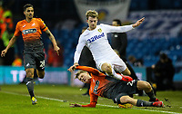 Leeds United's Patrick Bamford is tackled by Swansea City's George Byers<br /> <br /> Photographer Alex Dodd/CameraSport<br /> <br /> The EFL Sky Bet Championship - Leeds United v Swansea City - Wednesday 13th February 2019 - Elland Road - Leeds<br /> <br /> World Copyright © 2019 CameraSport. All rights reserved. 43 Linden Ave. Countesthorpe. Leicester. England. LE8 5PG - Tel: +44 (0) 116 277 4147 - admin@camerasport.com - www.camerasport.com