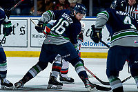 KELOWNA, BC - MARCH 6:  Kai Uchacz #16 of the Seattle Thunderbirds holds off Nolan Flamand #12 of the Kelowna Rockets after winning the face-off during third period at Prospera Place on March 6, 2020 in Kelowna, Canada. (Photo by Marissa Baecker/Shoot the Breeze)