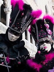 Masked people in Carnival or Carnevale in Venice Italy