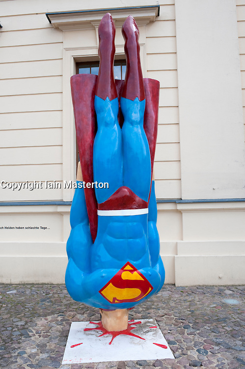 Humourous sculpture of Superman crashing to ground at Jewish museum in Berlin