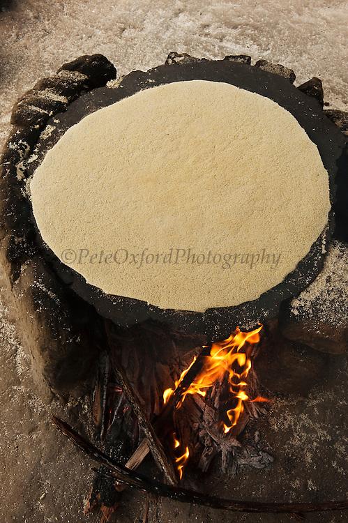 Making Cassava Bread.<br /> Katoka<br /> Rupununi<br /> GUYANA<br /> South America