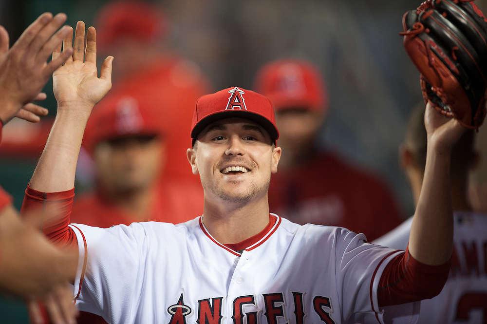 The Angels' Mike Morin is welcomed ingot eh dugout after pitching the seventh inning against the Kansas City Royals Tuesday night at Angel Stadium.<br /> <br /> ///ADDITIONAL INFO:   <br /> <br /> angels.0427.kjs-pre  ---  Photo by KEVIN SULLIVAN / Orange County Register  --  4/26/16<br /> <br /> The Los Angeles Angels take on the Kansas City Royals Tuesday at Angel Stadium.<br /> <br /> <br />  4/26/16