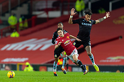 MANCHESTER, ENGLAND - Friday, January 1, 2020: Manchester United's Daniel James (L) and Aston Villa's Tyrone Mings during the New Year's Day FA Premier League match between Manchester United FC and Aston Villa FC at Old Trafford. The game was played behind closed doors due to the UK government putting Greater Manchester in Tier 4: Stay at Home during the Coronavirus COVID-19 Pandemic. (Pic by David Rawcliffe/Propaganda)