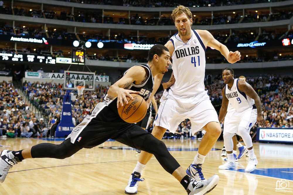 San Antonio Spurs shooting guard Danny Green (4) drives to the basket against Dallas Mavericks power forward Dirk Nowitzki (41) at American Airlines Center in Dallas, Texas, on January 25, 2013.  (Stan Olszewski/The Dallas Morning News)