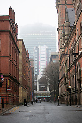 © Licensed to London News Pictures. 02/12/2020. Manchester, UK. A dreary day in the city centre of Manchester as the city enters Tier 3 restrictions. Photo credit: Kerry Elsworth/LNP