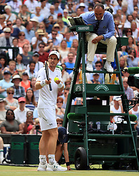 Andy Murray disputes a call made by match umpire Mohamed Lahyani on day seven of the Wimbledon Championships at The All England Lawn Tennis and Croquet Club, Wimbledon.