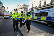 Police started arresting climate protestors after they imposed section 14 of the public order act on a protest of environmental activist group Extinction Rebellion who are gathered and blocked Oxford circus junction in central London on Wednesday, Aug 25, 2021. (VX Photo/ Vudi Xhymshiti)