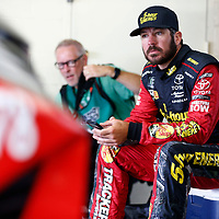 Martin Truex, Jr (78) hangs out in the garage during practice for the Consumers Energy 400 at Michigan International Speedway in Brooklyn, Michigan.
