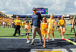 Sep 18, 2021; Morgantown, West Virginia, USA; West Virginia Mountaineers head coach Neal Brown walks off the field with his family after defeating the Virginia Tech Hokies at Mountaineer Field at Milan Puskar Stadium. Mandatory Credit: Ben Queen-USA TODAY Sports
