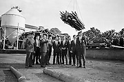 18/10/1962<br /> 10/18/1962<br /> 18 October 1962<br /> Senior Military Cadets visit Bowaters Irish Wallboard Mills Ltd. at Athy, Co. Kildare. The Cadets from the Military College, on the first of many visits to Irish Industry as part of the curriculum outside of military studies. Mr. Victor Sadgrove, Sales Manager, Bowaters, guiding the cadets on a tour describing the stacking of wood and feeding for chipping at the factory. Included are: Captain H. Crowley, Training Officer; Lieutenant B. Studdert: Cadets, S. Duffy; M. Canavan; W. Hanlon; W. Comber; P. Mulligan; J.P. Smyth; A. Eagar; S. Cummins and S. Duggan.