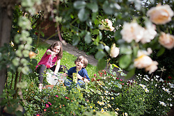 © Licensed to London News Pictures . 29/06/2013 . London , UK . Manuela Campo (10) and Marc Campo (three) play with toy snow in the sunshine in Finchley , North London today (Saturday 29th June)  . Photo credit : Joel Goodman/LNP