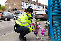 Forensics investigators conduct a fingertip search at the scene in Chalgrove Road, Tottenham, North London, where a seventeen year-old girl was shot dead on the evening of April 2nd. London, April 03 2018.